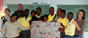 Rachel Elnaugh, Keith Upton, Paula Louw, headmistress Toksile Nxumalo Principal of the school and one of the teachers and the children who drew the pictures used for the design
